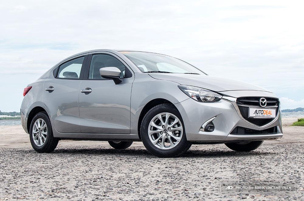 Grey Mazda 2 Sedan