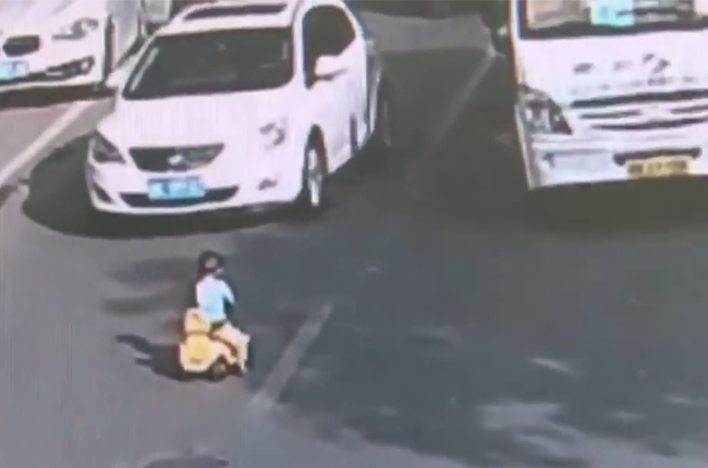 WATCH: Toddler drives through oncoming traffic