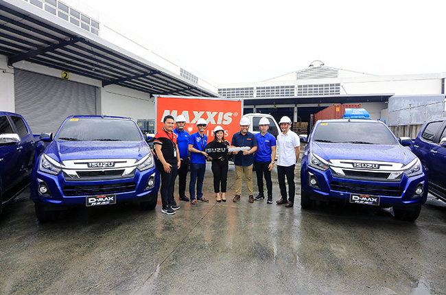 Isuzu PH turns over D-Max units, QKR truck to Excel Trend Group