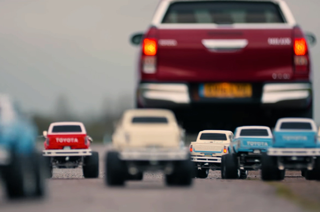 Toyota Hilux followed by a squad of Tamiya Bruisers
