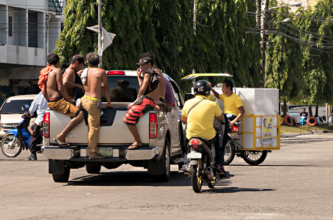 Is it illegal to ride in the back of a pickup in the Philippines?