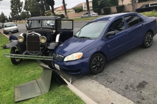 Toyota Corolla crashes into 1931 Ford Model A