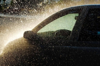 How can rain damage my car?
