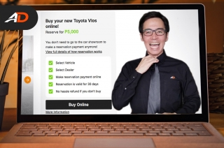 How to buy a car online with AutoDeal - Behind a Desk