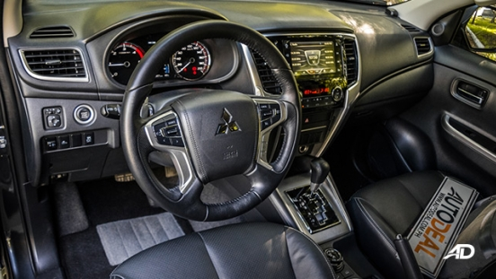mitsubishi strada review road test front cabin interior