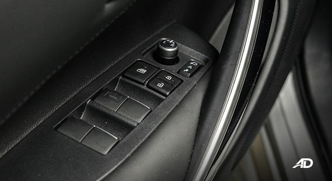 Toyota corolla altis hybrid review road test door controls interior