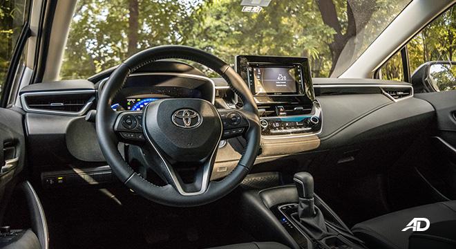 Toyota corolla altis hybrid review road test steering wheel interior