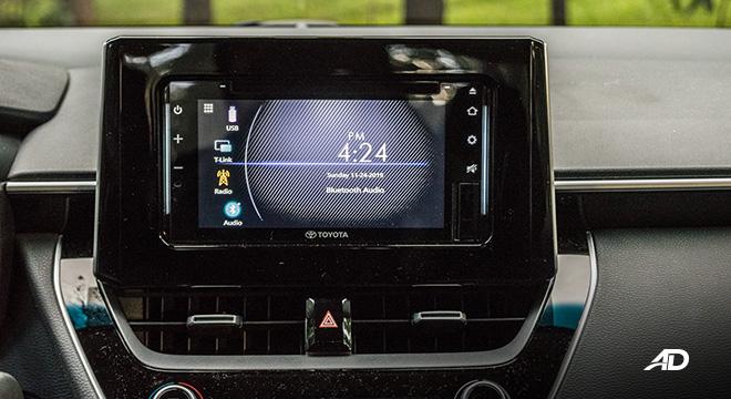 Toyota corolla altis hybrid review road test touchscreen infotainment interior