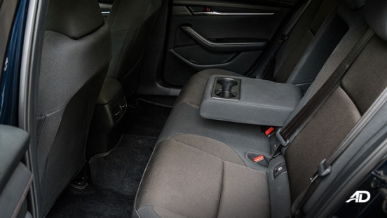 mazda3 elite sedan review road test rear cabin cupholders interior