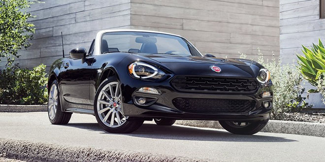 Fiat 124 spider black press photo